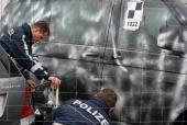 Police men investigate a car at a car dealership on March 12 2009 in Wendlingen near Stuttgart Germany17 year old Tim Kretschmer opened fire...
