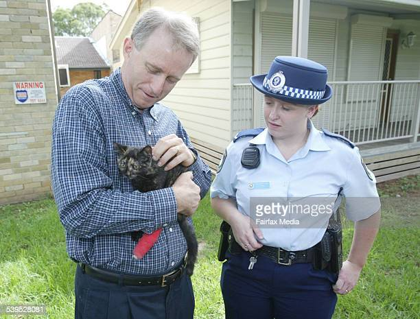 Police Minister Carl Scully with kitten Shelley that was saved by Constable Michelle Moy 29 January 2005 SHD Picture by SIMON ALEKNA