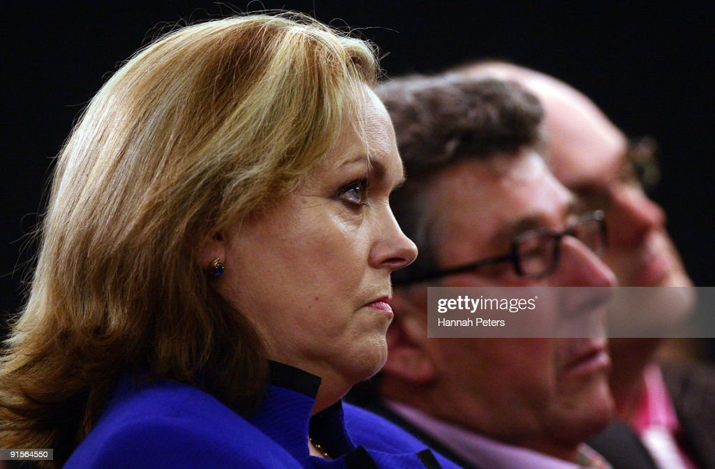 Police Minister Judith Collins listens to New Zealand Prime Mininster John Key announce the government's new anti-pseudoephedrine package on October 8, 2009 in Auckland, New Zealand. The government has announced a ban on over-the-counter sale of the drug pseudoephedrine, or P, which is commonly used in cold and flu medications. Addiction to the drug has become an increasing problem in New Zealand and the government will invest a further NZ$22 million for P treatment over the next three years and increase investment in special detox facilities.