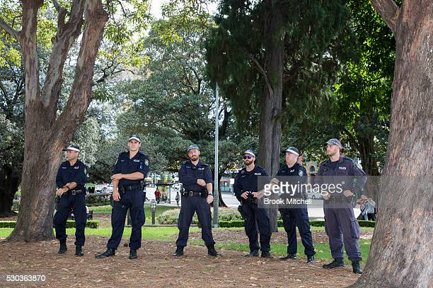 Police monitor students protesting against funding cuts to higher education at Sydney University on May 11 2016 in Sydney Australia The protests soon...