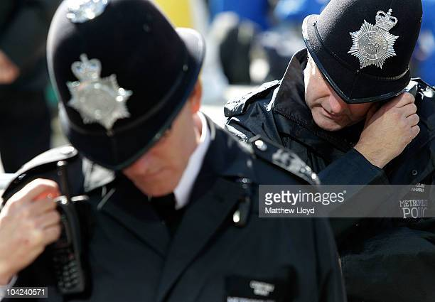 Police monitor the crowd outside Westminster Cathedral as Pope Benedict XVI conducts Mass on September 18 2010 in London England Pope Benedict XVI is...