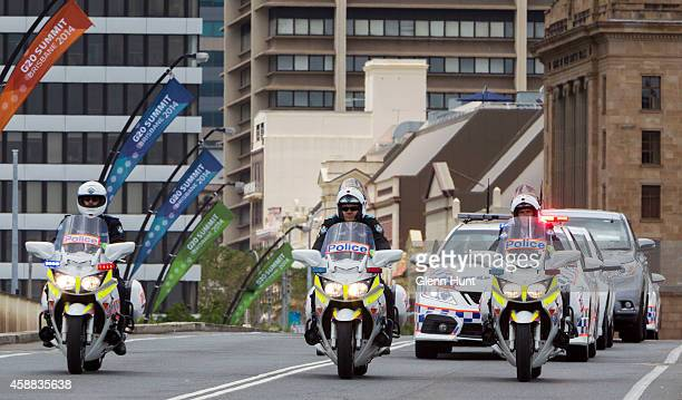 A police motorcade transporting delegates to and from their hotels is seen ahead of the G20 Leaders Summit on November 12 2014 in Brisbane Australia...