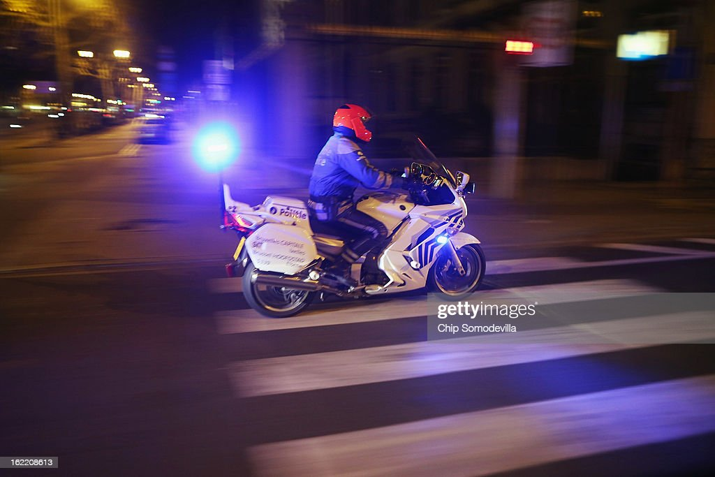 A police motorcycle escorts U.S. Secretary of Defense Leon Panetta's motocade to his hotel February 20, 2013 in Brussels, Belgium. Panetta is in Brussels for a meeting of NATO defense ministers.