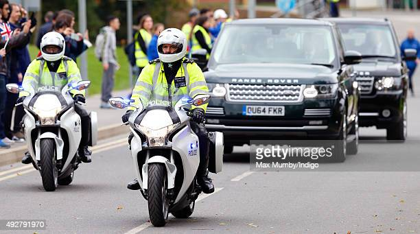 Police Motorcycle Outriders of the Special Escort Group lead Queen Elizabeth II's Range Rover car as she departs the School of Veterinary Medicine at...