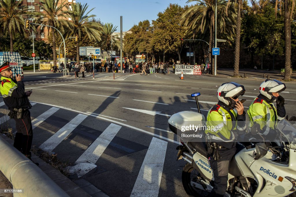 Police motorcyclists stand by as protesters blockade city roads during a regional strike called by pro-independence union in Barcelona, Spain, on Wednesday, Nov. 8, 2017. Spanish Prime MinisterMariano Rajoyinvoked extraordinary powers last month to reassert his authority over Catalonia and fire Catalan presidentCarles Puigdemont and his government.Photographer: Angel Garcia/Bloomberg via Getty Images