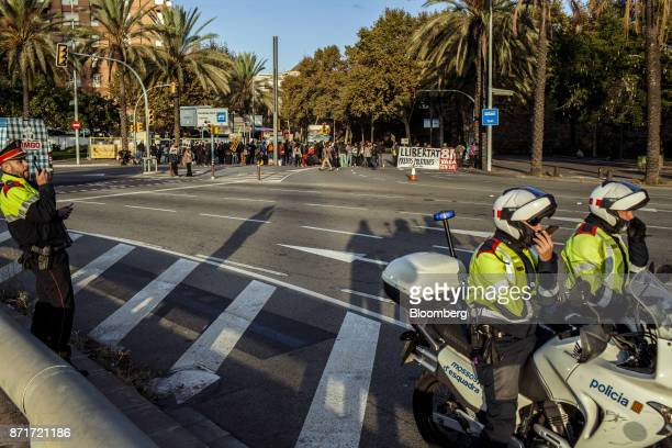 Police motorcyclists stand by as protesters blockade city roads during a regional strike called by proindependence union in Barcelona Spain on...