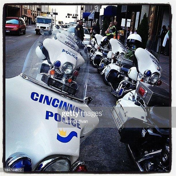 Police motorcyles line up for to Republican presidential candidate former Massachusetts Gov Mitt Romney on October 25 2012 in Cincinnati Ohio Mitt...