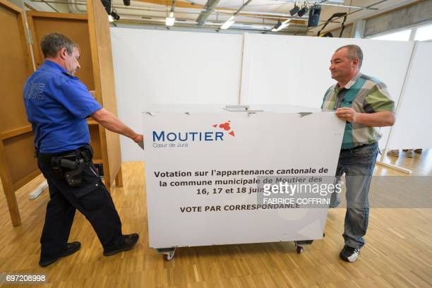 Police move a giant ballot box during an election concerning the cantonal membership of the commune of Moutier on June 18 2017 in Moutier northern...