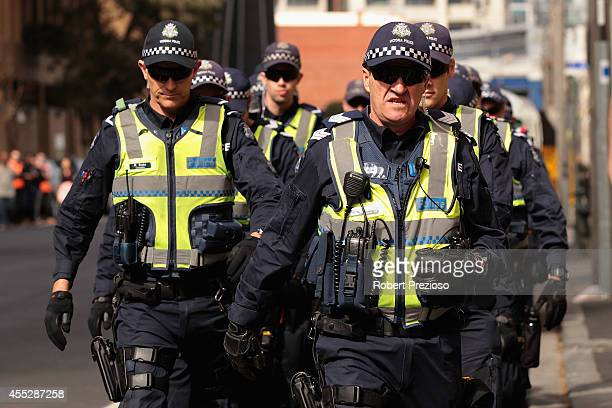 Police move in as protesters gather outside as Prime Minister Tony Abbott opens the Peter Doherty Institute for Infection and Immuminty facility on...