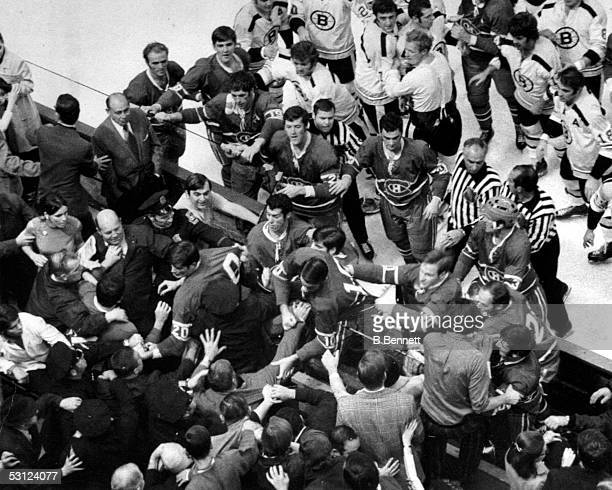 Police move in to break up a fight between Boston Bruin fans and the Montreal Canadiens Derek Sanderson and Phil Roberto started it on the bench and...