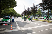Police near OEZ shopping center the day after a shooting spree left nine victims dead on July 23 2016 in Munich Germany According to police an...