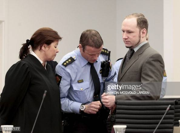 A police office remove the handcuffs of Norwegian 33yearold right wing extremist Anders Behring Breivik as he arrives with his lawyer Vibeke Hein...