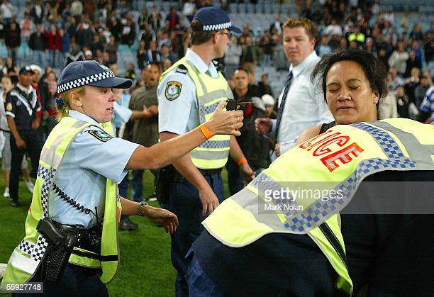 A police office uses Pepper Spray while trying to make an arrest after the TriNations Rugby League Test match between Australia and New Zealand at...