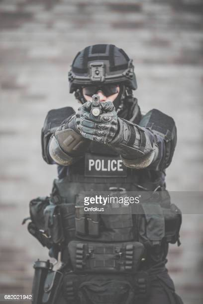 SWAT Police Officer Against Brick Wall