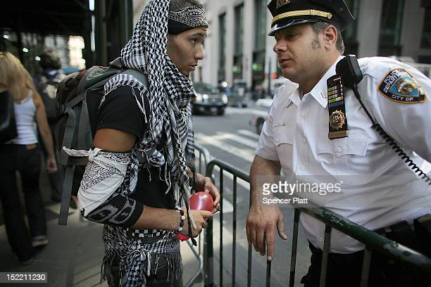 A police officer and a protester with 'Occupy Wall Street' speak during demonstrations on September 17 2012 in New York City The 'Occupy Wall Street'...