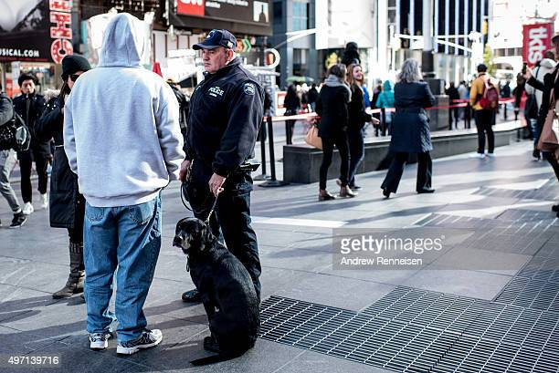 A police officer and his dog keep watch in Times Square following a series of terrorist attacks in Paris on November 14 2015 in New York City...