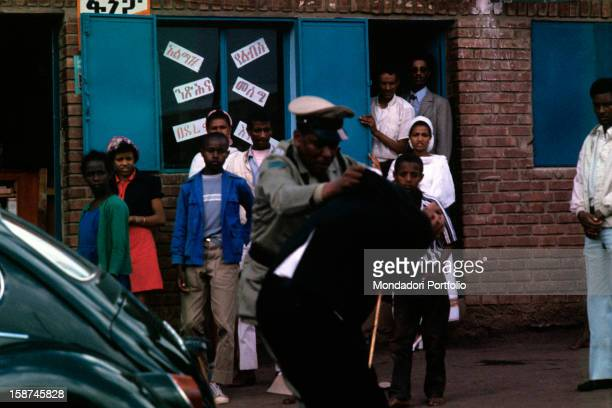 A police officer arrests a university student during the troubles for the putsch when the Negus Hailé Selassié was dismissed Addis Abeba settember...