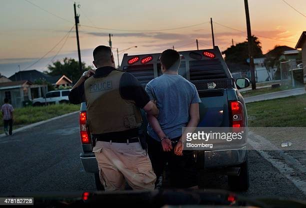 A police officer arrests a young man for public intoxication while patroling the streets of Rio Grande City Texas US on Wednesday June 10 2015 The...