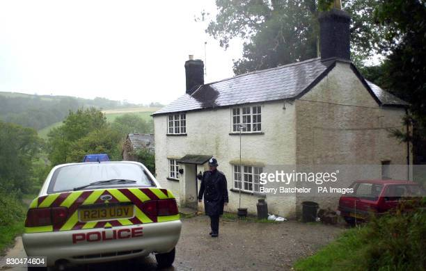 A police officer at Brandispiece Cottage on Leigh Farm near Tideford Cornwall where the body of a 17yearold girl was found in a bedroom on the first...
