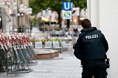 A police officer at Stachus in the city center responds to the shooting at the Olympia Einkaufzentrum on July 22 2016 in Munich Germany According to...