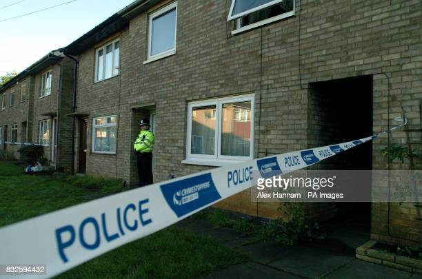 A police officer attends to the aftermath of a tragic blaze in Dupont Gardens New Parks Leicester Press Association Photo Picture Date Saturday...