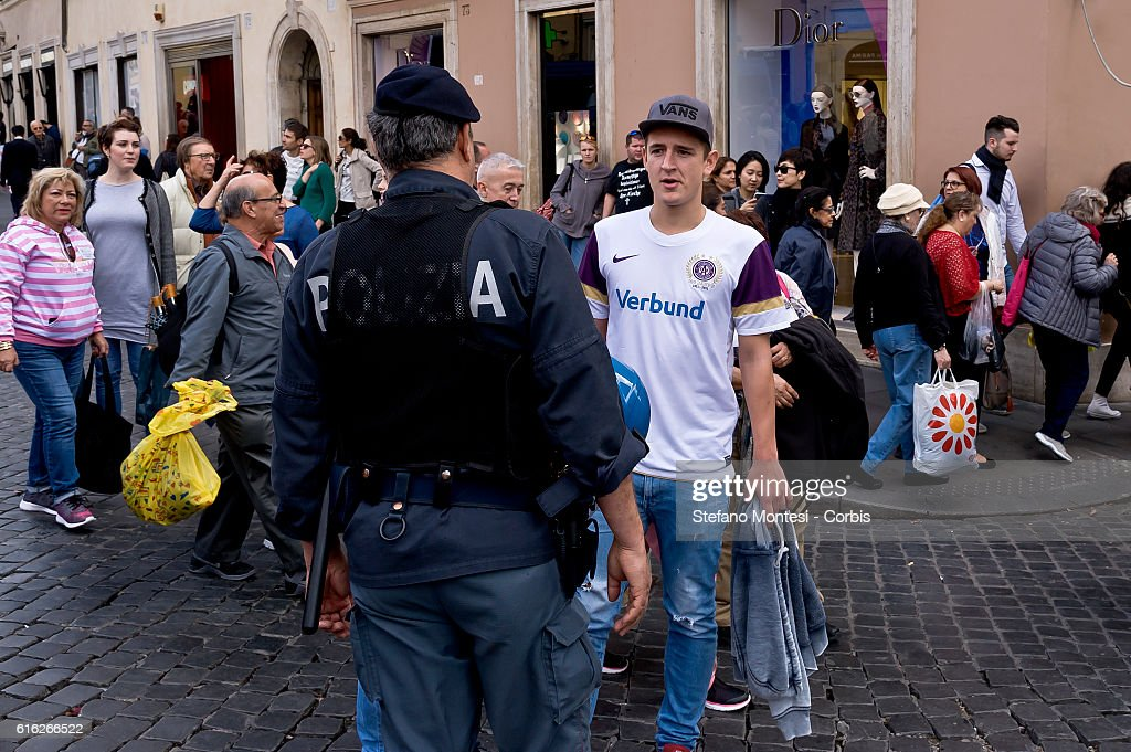 A police officer blocks an FK Austria Wien supporters from making their way to the Spanish Steps ahead of the UEFA Europa League match between AS Roma and FK Austria Wien, that will take place tonight at the Olympic Stadium on October 20, 2016 in Rome, Italy.