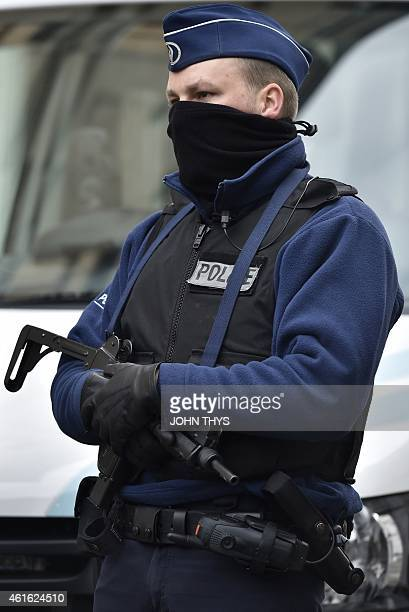 A police officer blocks the Colline street in Verviers eastern Belgium on January 16 after police shot dead two suspects in a gun battle after they...