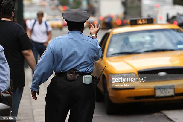 A police officer calls over a taxi cab on June 23 2009 in New York City A Manhattan federal judge halted Monday New York's latest attempt to force...