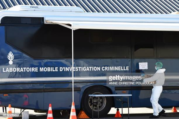 A police officer carries DNA samples of victims of the Germanwings air crash to be tested at a mobile laboratory set up by the gendarmerie in...