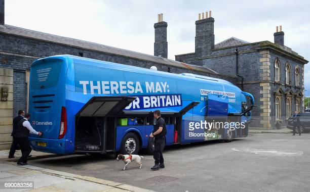 A police officer carries out a security check on the Conservative Party general election campaign bus in Wolverhampton UK on Tuesday May 30 2017 The...