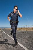 Police Officer Chasing Criminal on Roadway