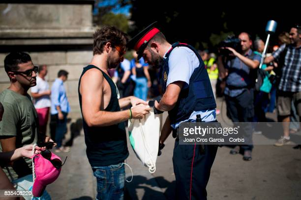 A police officer checking the bag of a concentration assistant the day after the terrorist attack on August 18 2017 in Barcelona Spain