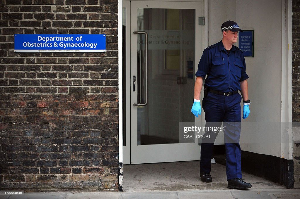 A police officer checks the entrance to the gynaecology building near the Lindo Wing of Saint Mary's Hospital in London, on July 12, 2013, where Prince William and his wife Catherine's baby will be born. Britain's royal family and the world's media are on tenterhooks awaiting the birth of Prince William and wife Catherine's first child, a baby who will one day be king or queen of Britain and a diverse group of commonwealth countries.