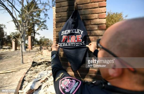 Police officer Chris Albert views a tshirt left on the chimney of a burned out property in Santa Rosa California on October 12 2017 Hundreds of...