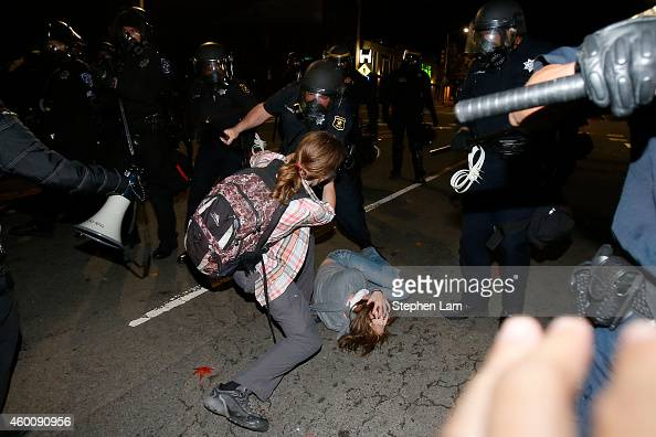 A police officer clashes with a protester during a demonstration over recent grand jury decisions in policeinvolved deaths on December 7 2014 in...