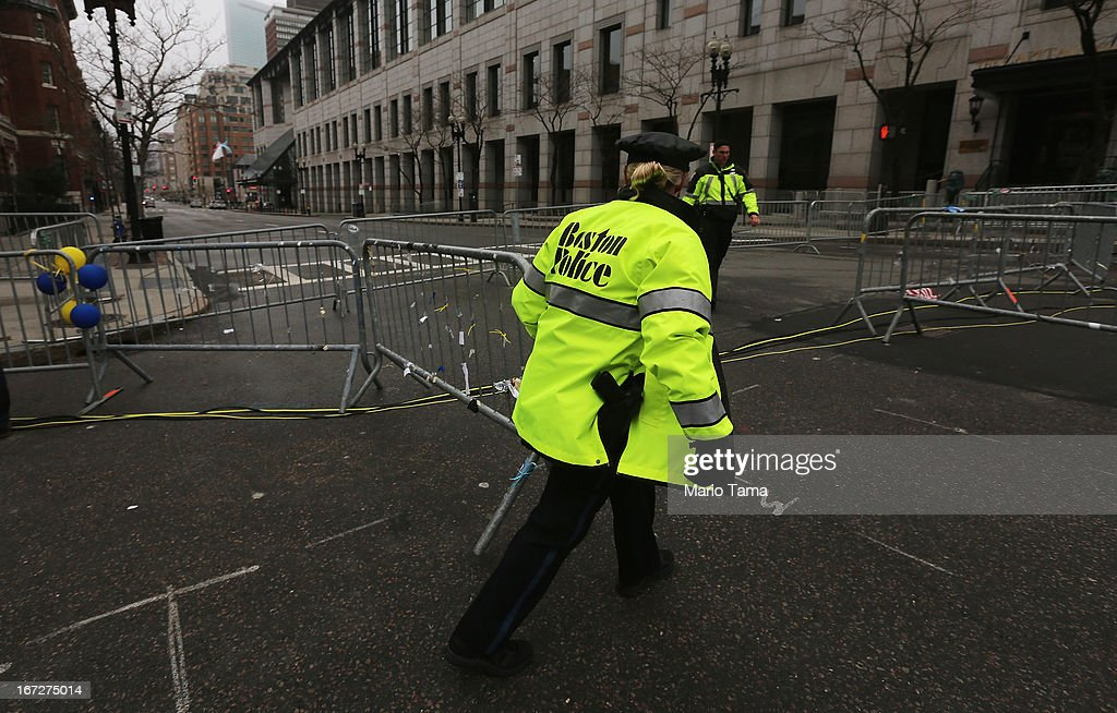 A police officer closes a barricade blocking a still closed section of Boylston Street near the site of the Boston Marathon bombings on April 23, 2013 in Boston, Massachusetts. Business owners and residents of the closed section were allowed to return to their properties today while under escort of city staff.