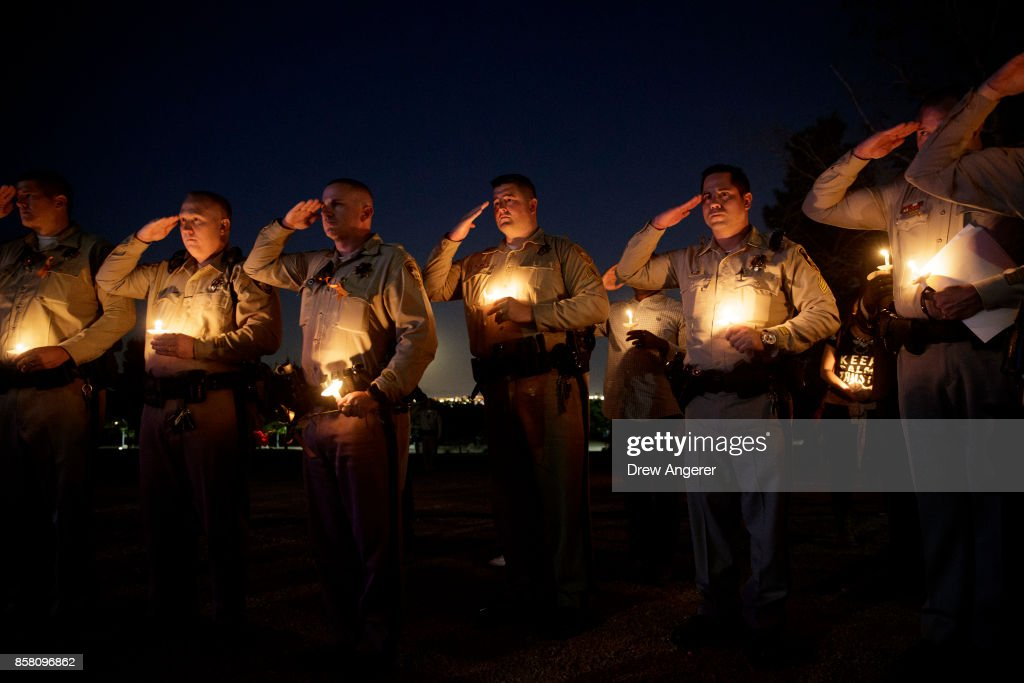 Police officer colleagues of Las Vegas Metropolitan Police Department Officer Charleston Hartfield salute while 'Taps' is played during a vigil for Hartfield at Police Memorial Park on October 5, 2017 in Las Vegas, Nevada. Hartfield, who was off duty at the Route 91 Harvest country music festival on October 1, was killed when Stephen Paddock opened fire on the crowd killing at least 58 people and injuring more than 450. The massacre is one of the deadliest mass shooting events in U.S. history.