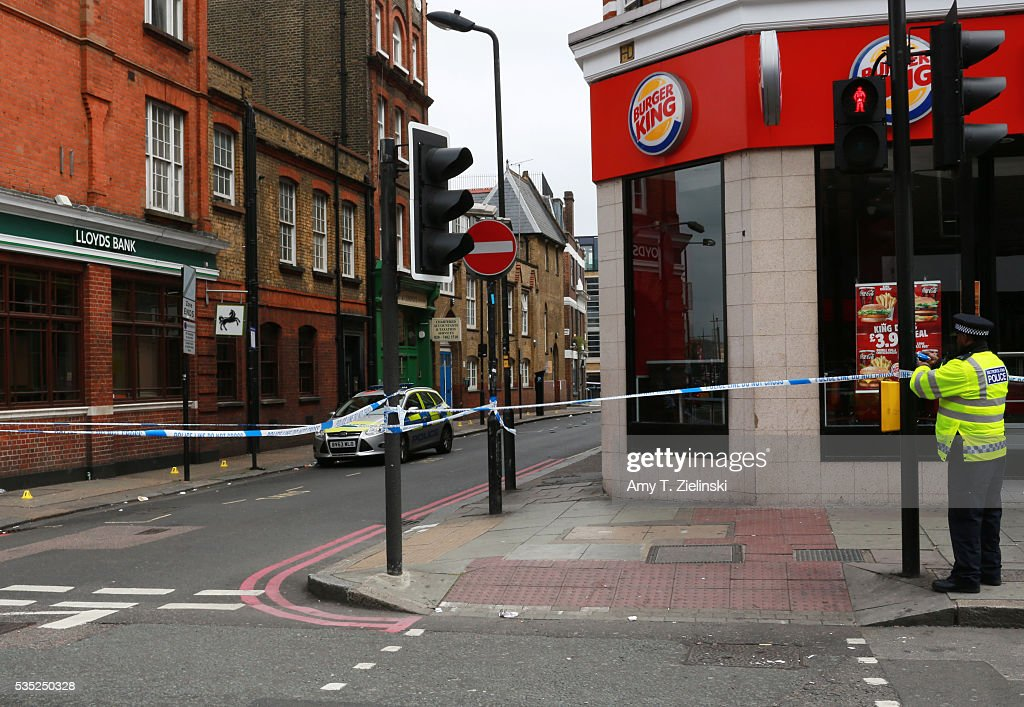 A police officer cordons off a section of Camden High street as a murder investigation is underway in Camden on May 29, 2016 in London, England. Reportedly a stabbing took place in the area leaving one man dead after being taken to the hospital.