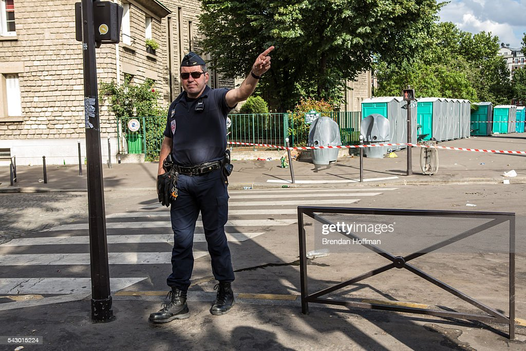 A police officer directs people away from portable toilets, suspected of holding a possible bomb, near the Parc des Princes stadium during the football match between Wales and Northern Ireland during UEFA Euro 2016 tournament on June 25, 2016 in Paris, France. There was no bomb. The two teams met in the Round of 16 at Parc des Princes in Paris, where Wales won 1-0.