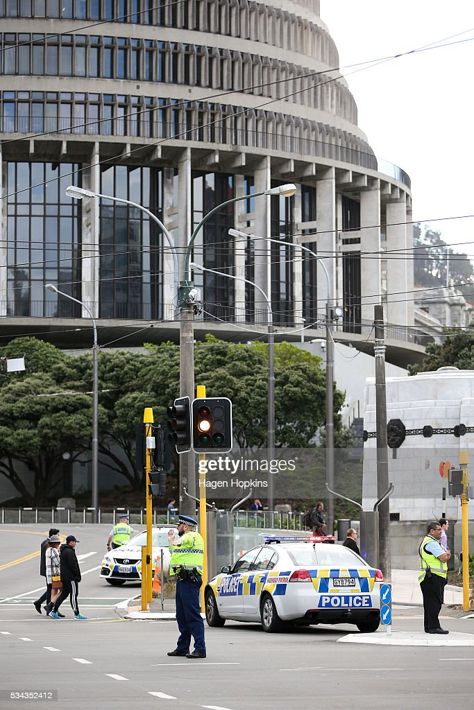 A police officer directs traffic on Lambton Quay following an incident at Parliament on May 26, 2016 in Wellington, New Zealand. Police have blocked off the Parliamentary forecourt and the front entry point because of a truck stationed outside the Beehive, and have taken a man into custody following the incident on Thursday morning, the day of the national Budget release.