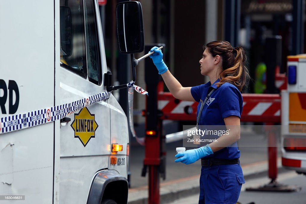 A police officer dusts an Armaguard truck for fingerprints along Bay Street, Broadway on March 4, 2013 in Sydney, Australia. Shots were reportedly fired at an Armaguard truck and police are investigating what a spokesperson said appears to be an attempted robbery.