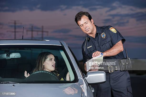 Police Officer Explaining Citation to Woman Driver