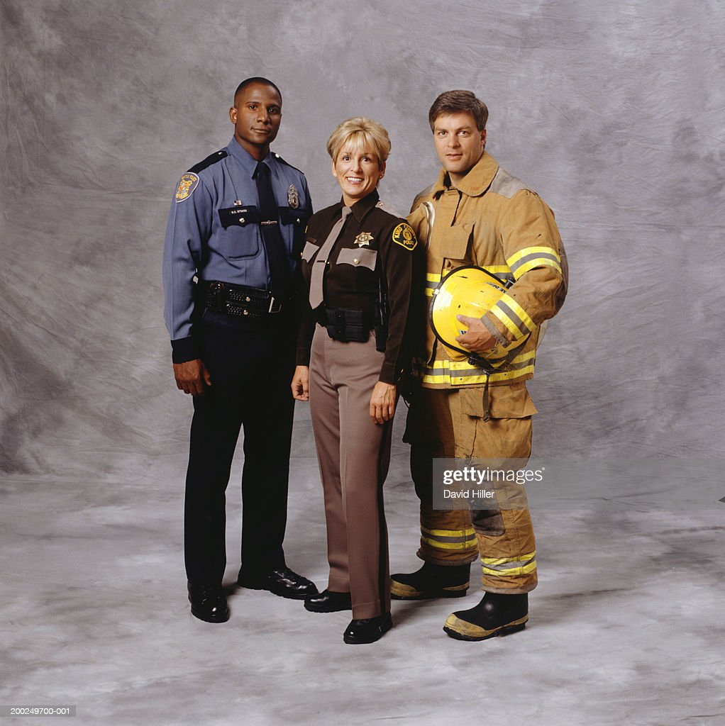 Police And Media: Police Officer Firefighter And Sheriff Stock Photo