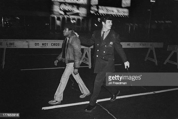 A police officer from Midtown South Precinct arrests a man for pickpocketing revellers at the New Years Eve celebrations in Times Square New York...