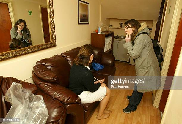 A Police officer from the clubs and vice unit interviews a woman during a raid on the 'Ishka' sauna 'Ishka' Sauna Hampden road Honesey North London...