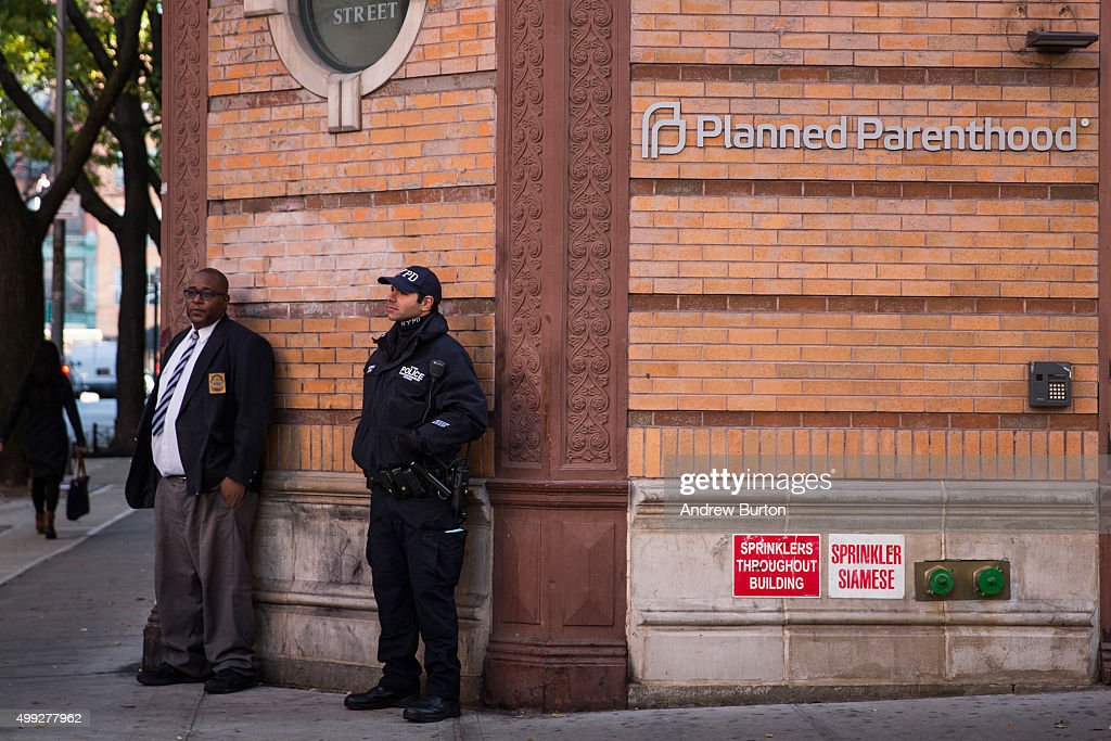 A police officer from the counterterrorism department stands guard outside Planned Parenthood on November 30, 2015 in New York City. A gunman killed three people November 27, including a police officer, at a Planned Parenthood in Colorado Springs, Colorado.