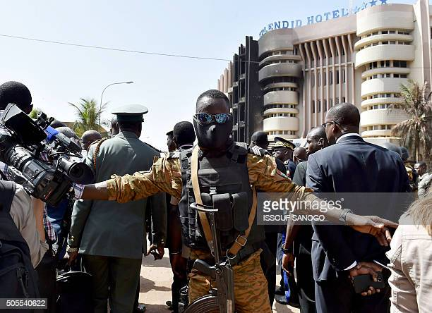 A police officer gestures during a visit by Burkina Faso's and Benin's presidents to the Splendid hotel and the Capuccino cafe on January 18 2016 in...