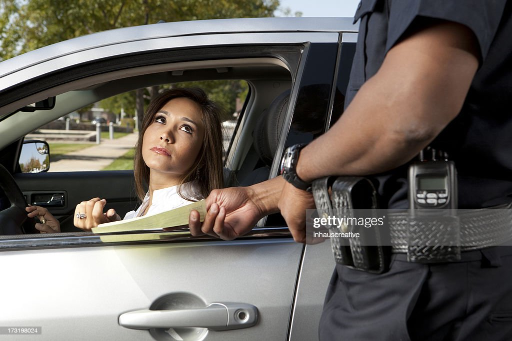 Police Officer giving a ticket : Stock Photo