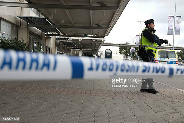A police officer guard the cornered off domestic flight terminal at Goteborg Landvetter airport after a bomb threat on March 31 2016 A bomb squad has...