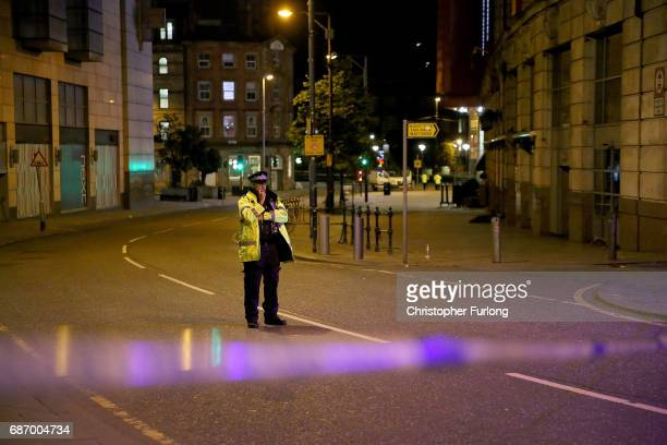 A police officer guards the scene near Manchester Arena on May 23 2017 in Manchester England An explosion occurred at Manchester Arena as concert...
